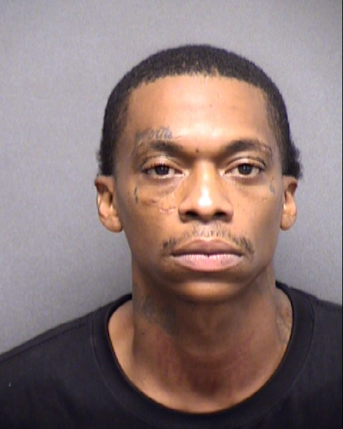 Raushaun Rashid Al-Sharrif Harris, 35, was charged in connection with the fatal shooting of Cameron Terrell Woods outside an East Side gas station on May 19, 2020.