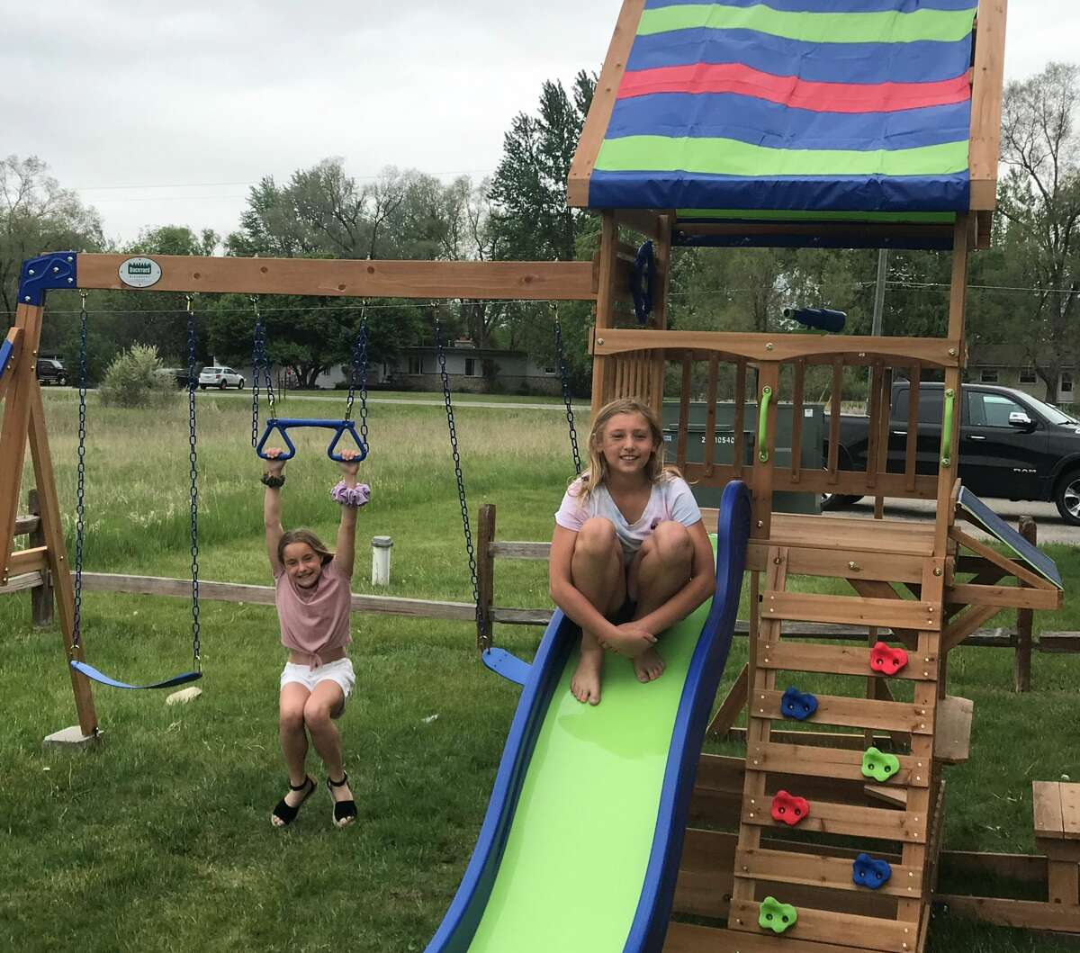 Lulu Church and Hailey Swingle enjoy the new playset at Midland Eagles Aerie 2110 they helped fund and construct.