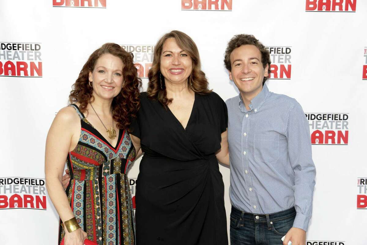 State officials Rep. Aimee Berger-Girvalo, left, and Sen. Will Haskell pose with Ridgefield Theater Barn's Executive Director Pamme Jones on the red carpet during the barn's reopening night on June 11.