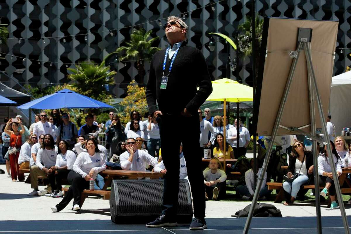 Golden State Warriors president Rick Welts at his retirement party at Chase Center, Thursday, June 24, 2021, in San Francisco, Calif. Welts looks up at the digital display outside the center that projects video clips during Welts' career.