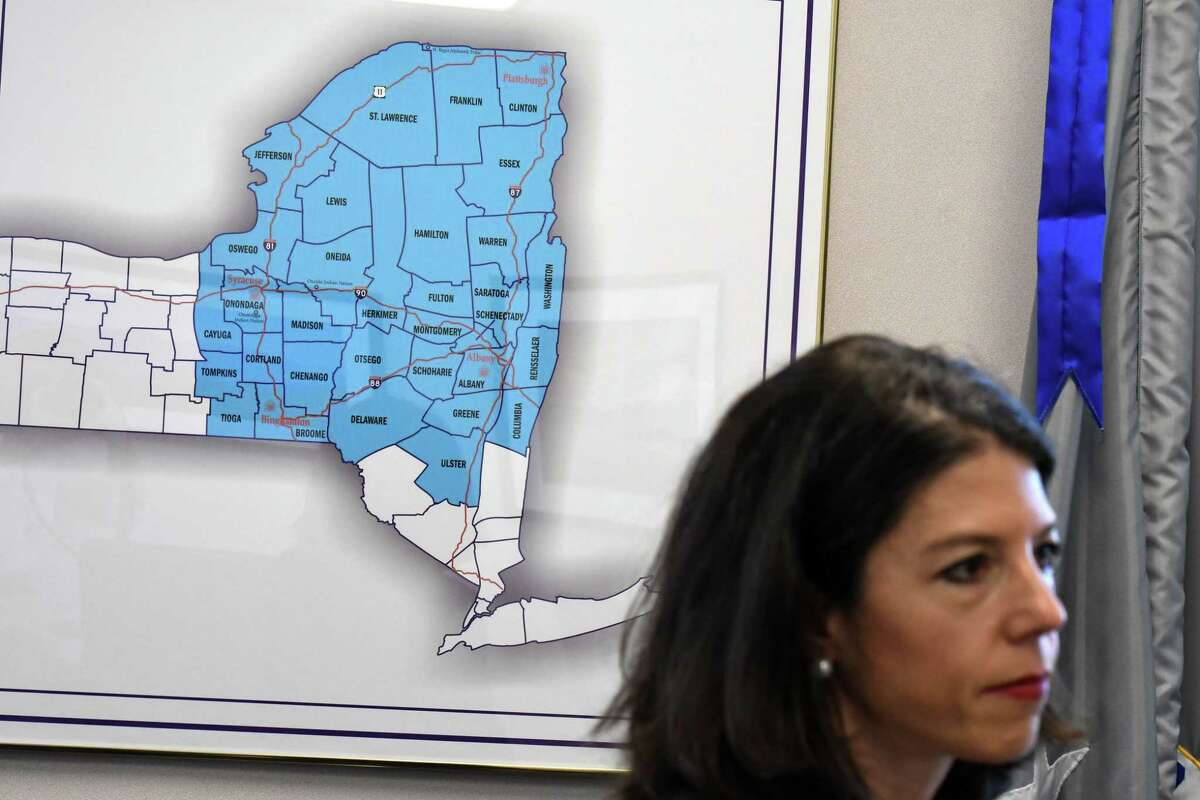 A map showing the Northern District of New York where Acting U.S. Attorney Antoinette Bacon presides is displayed behind her on Friday, June 25, 2021, in her offices at the James T. Foley U.S. Courthouse in Albany N.Y. Her office is investigating loan fraud in the Paycheck Protection Program and other coronavirus business loans issued by the Small Business Administration. (Will Waldron/Times Union)