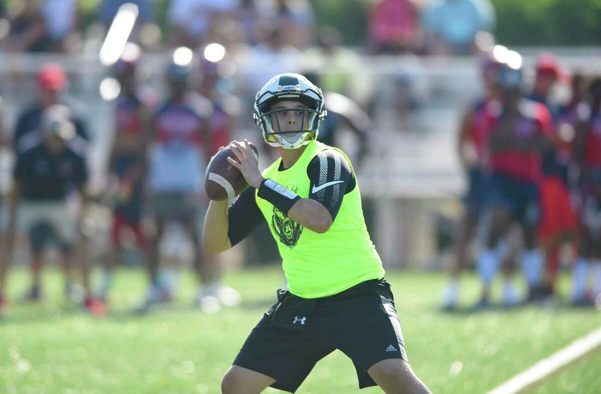 Norwalk quarterback Tommy Brown passes during the annual Rip It and Grip It tournament in 2019.