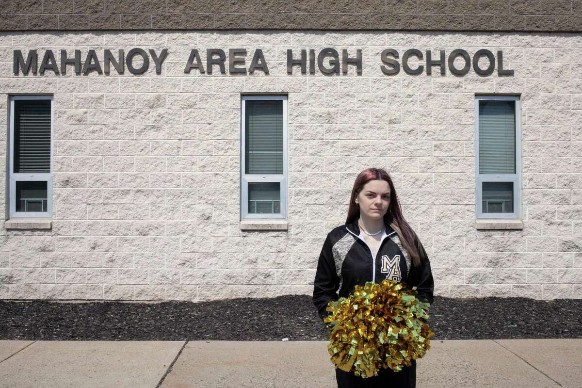 This undated image released courtesy of the ACLU (American Civil Liberties Union) shows student cheerleader Brandi Levy in front of the Mahanoy High school in Mahanoy, Pennsylvania.