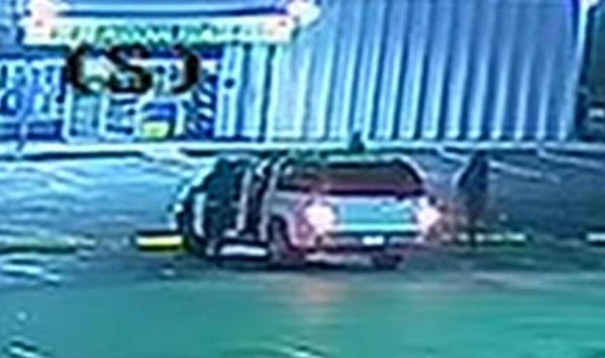 Surveillance footage shows a white Chevrolet SUV pull up and two males get out and call to Elsa Mikeska before one of them fatally shot her, according to police.