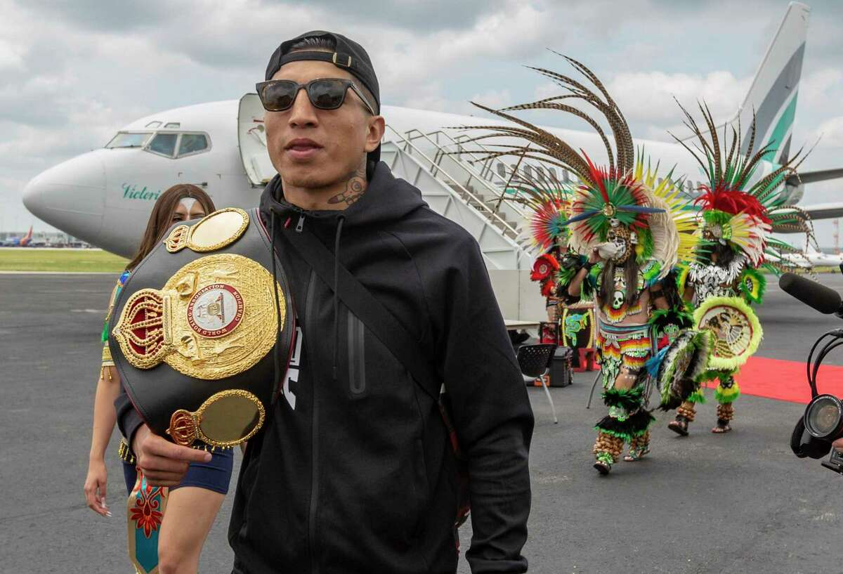"""Mario ?'El Azteca?"""" Barrios, the undefeated WBA Super Lightweight boxing champion, walks to a press conference Tuesday afternoon June 22, 2021, during a brief stop at the San Antonio airport to promote his Saturday fight against Two-Division World Champion Gervonta ?'Tank?"""" Davis."""