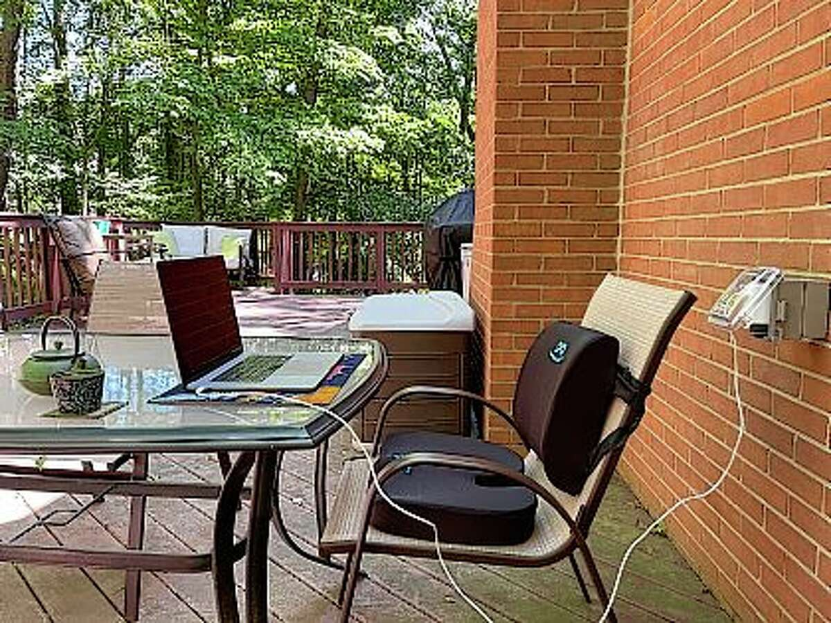A lumbar pillow and seat cushion added to an outdoor dining chair help create a more ergonomic outdoor workspace.