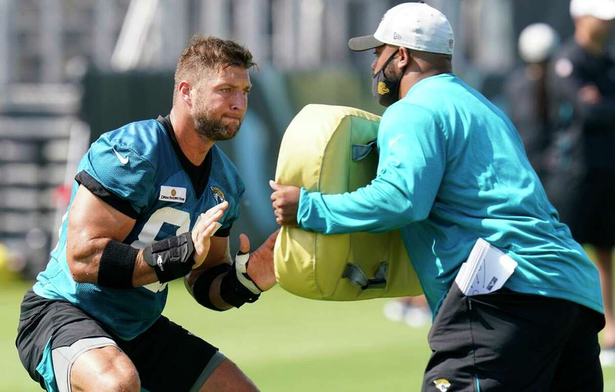 Tim Tebow (left) is getting a look with the Jacksonville Jaguars as a tight end, a position he has no experience in.
