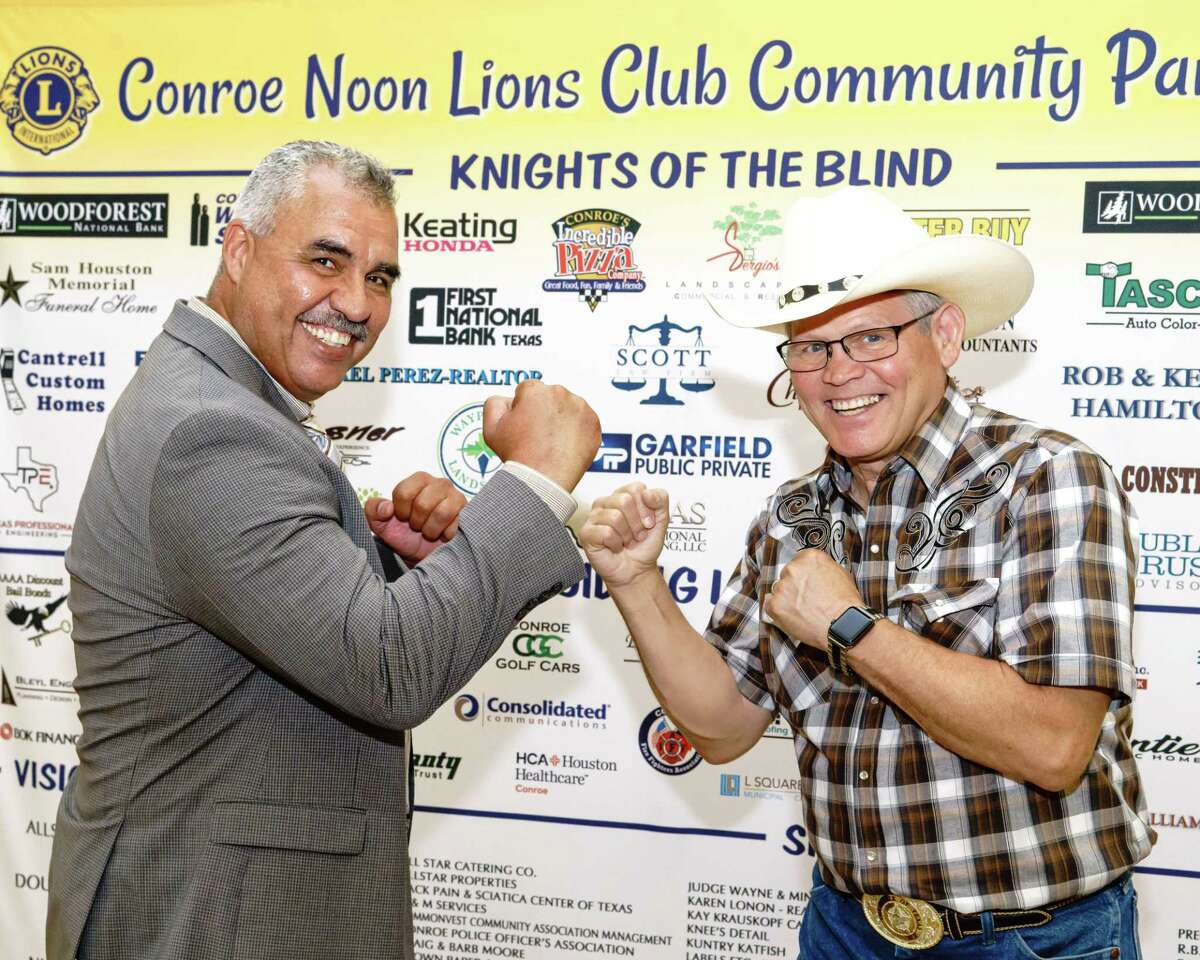 The Conroe Noon Lions Club held their annual Community Partners Appreciation Luncheon last week with boxing legend Maurice 'Termite' Watkins, right, giving a punch of a program and taking air at Club President Ralph Perez, left.