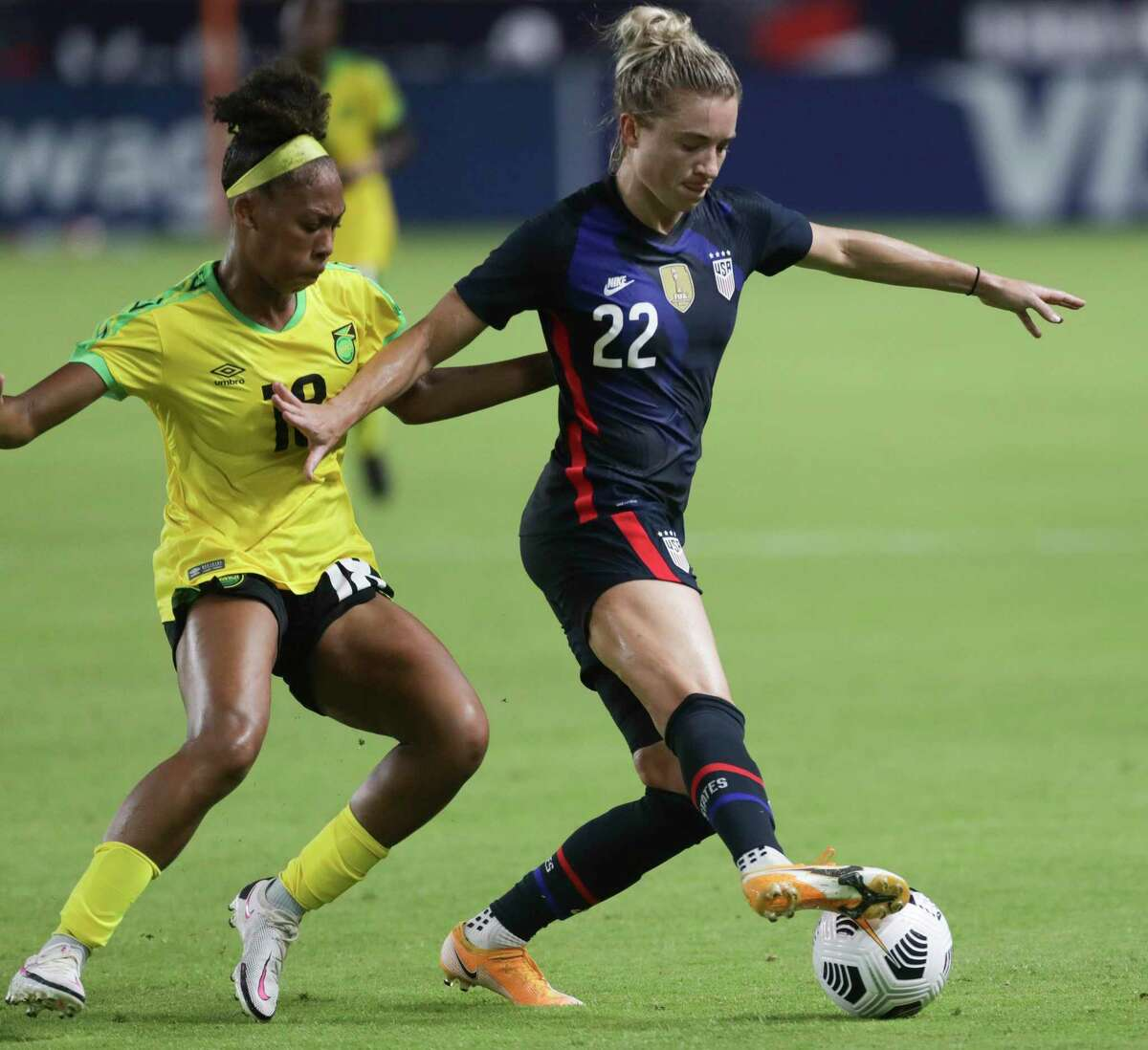 U.S. Women's National Team midfielder Kristie Mewis (22) keeps control of the ball while Jamaica Women's National Football Team midfielder Tierney Wiltshire (18) is defensing during the second half of 2021 Summer Series match Sunday, June 13, 2021, at BBVA Stadium in Houston. The U.S. Women's National Team defeated the against the Jamaica Women's National Football Team 4-0.