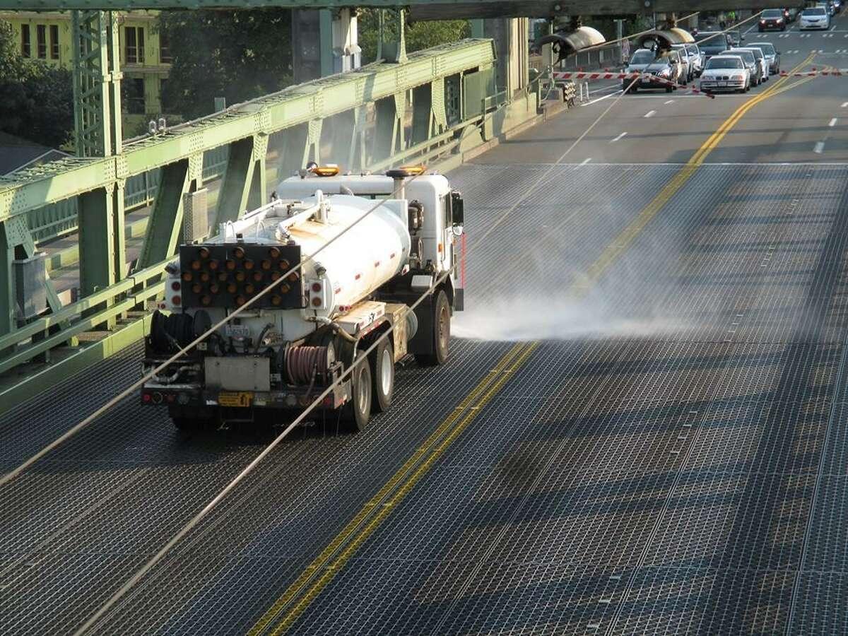 A water cooler truck cools down a steel bridge.