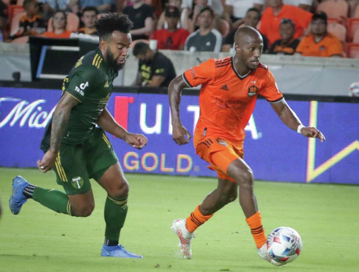 Fafa Picault, right, and the Dynamo could do no better than a draw in their last meeting with Eryk Williamson and the Timbers in June.