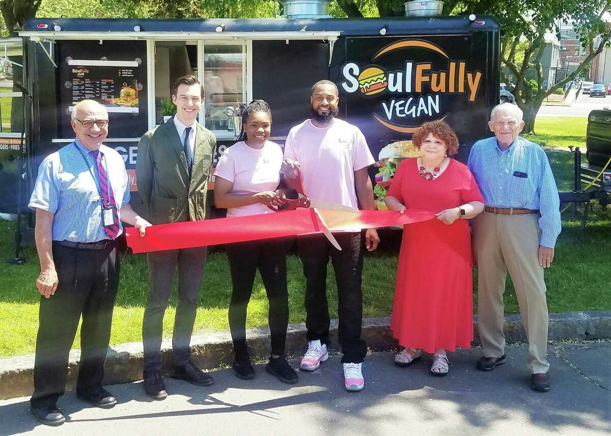 The Soulfully Vegan food truck celebrated a grand opening in May. From left are Middletown Economic Development Specialist Thomas Marano, Mayor Ben Florsheim, co-owners Allison Vaughan and her husband Calvin Vaughan, Middlesex County Chamber of Commerce Central Business Bureau Chairwoman Pamela Steele and President Larry McHugh.