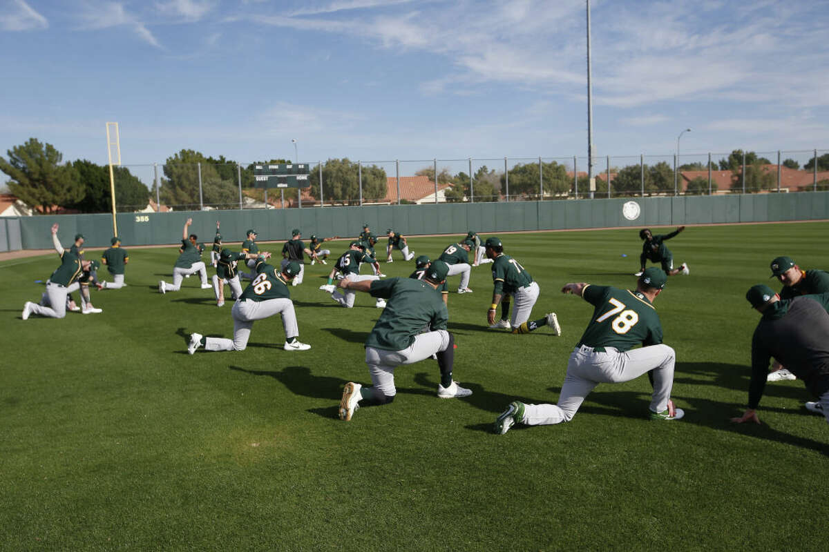 The Oakland Athletics stretch during a workout at Fitch Park on Feb. 19, 2020 in Mesa, Arizona.