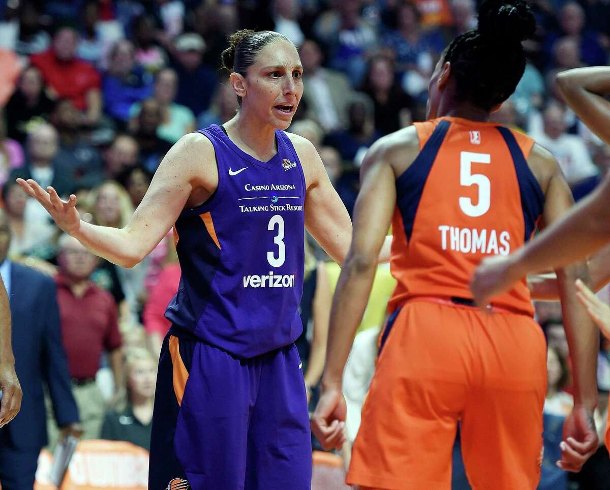 Connecticut Sun guard Jasmine Thomas (5) confronts Phoenix Mercury guard Diana Taurasi after being fouled during the first half of a single-elimination WNBA basketball playoff game Thursday, Aug. 23, 2018, in Uncasville, Conn. (Sean D. Elliot/The Day via AP)