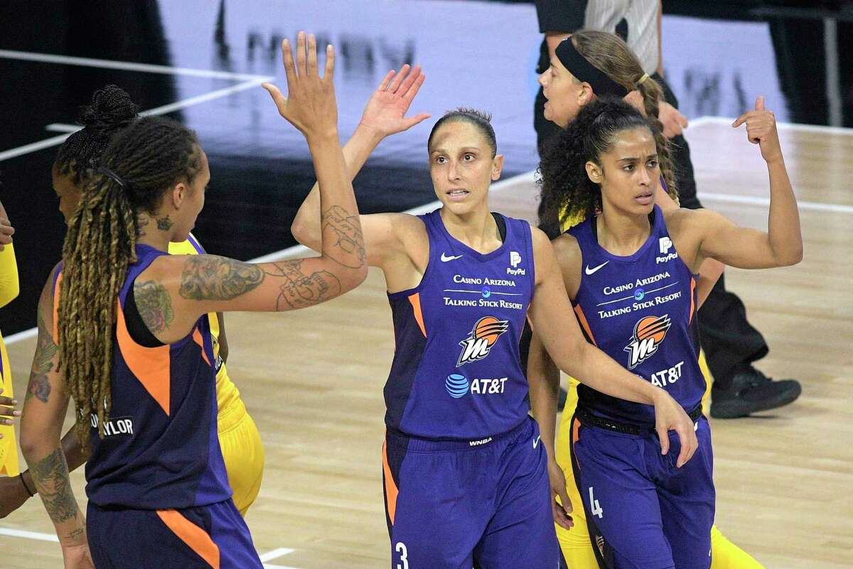 Phoenix Mercury guard Diana Taurasi (3) is congratulated by center Brittney Griner, left, and Skylar Diggins-Smith (4) after scoring a basket during the first half of a WNBA basketball game against the Los Angeles Sparks, Saturday, July 25, 2020, in Ellenton, Fla. (AP Photo/Phelan M. Ebenhack)