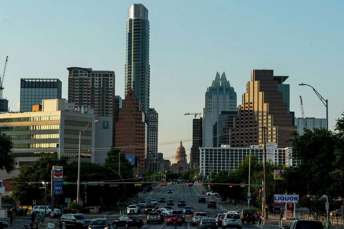 The downtown skyline of Austin. The city sees about 180 people move to it every day, a sizable chunk of them coming from California.