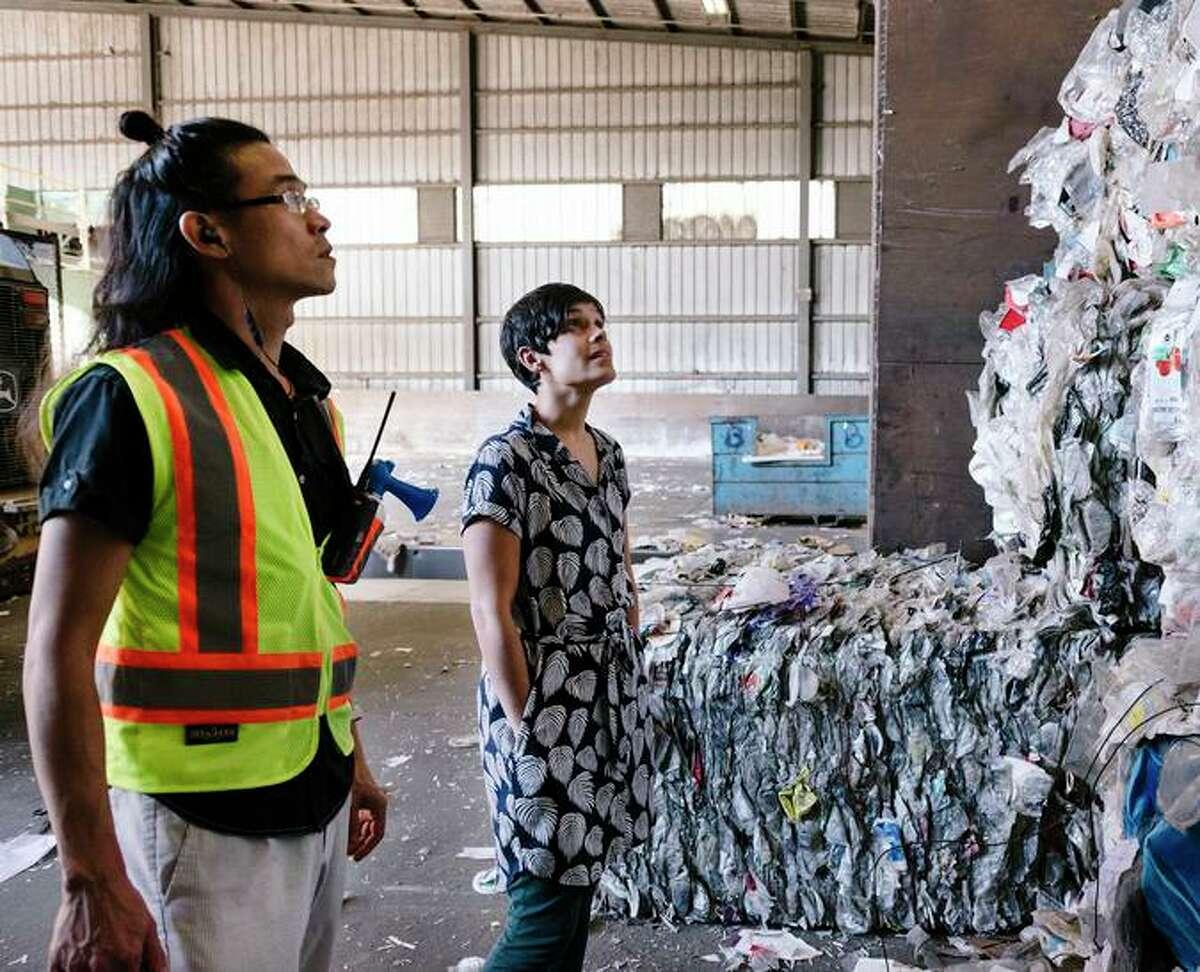Berkeley Recycling Center customer service coordinator Ignacio Zulueta (left) and Earth Island Institute's general council, Sumona Majumdar, look over bails of plastics last year.