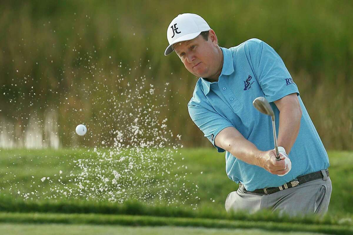 J.J. Henry plays a shot from a bunker on the second hole during the first round of the Honda Classic at PGA National Resort and Spa in 2019 in Palm Beach Gardens, Fla.