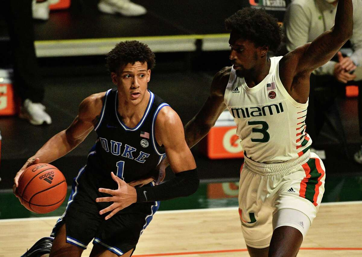 MIAMI, FLORIDA - FEBRUARY 01: Jalen Johnson #1 of the Duke Blue Devils drives to the basket against Nysier Brooks #3 of the Miami Hurricanes during the first half at Watsco Center on February 01, 2021 in Miami, Florida. (Photo by Mark Brown/Getty Images)