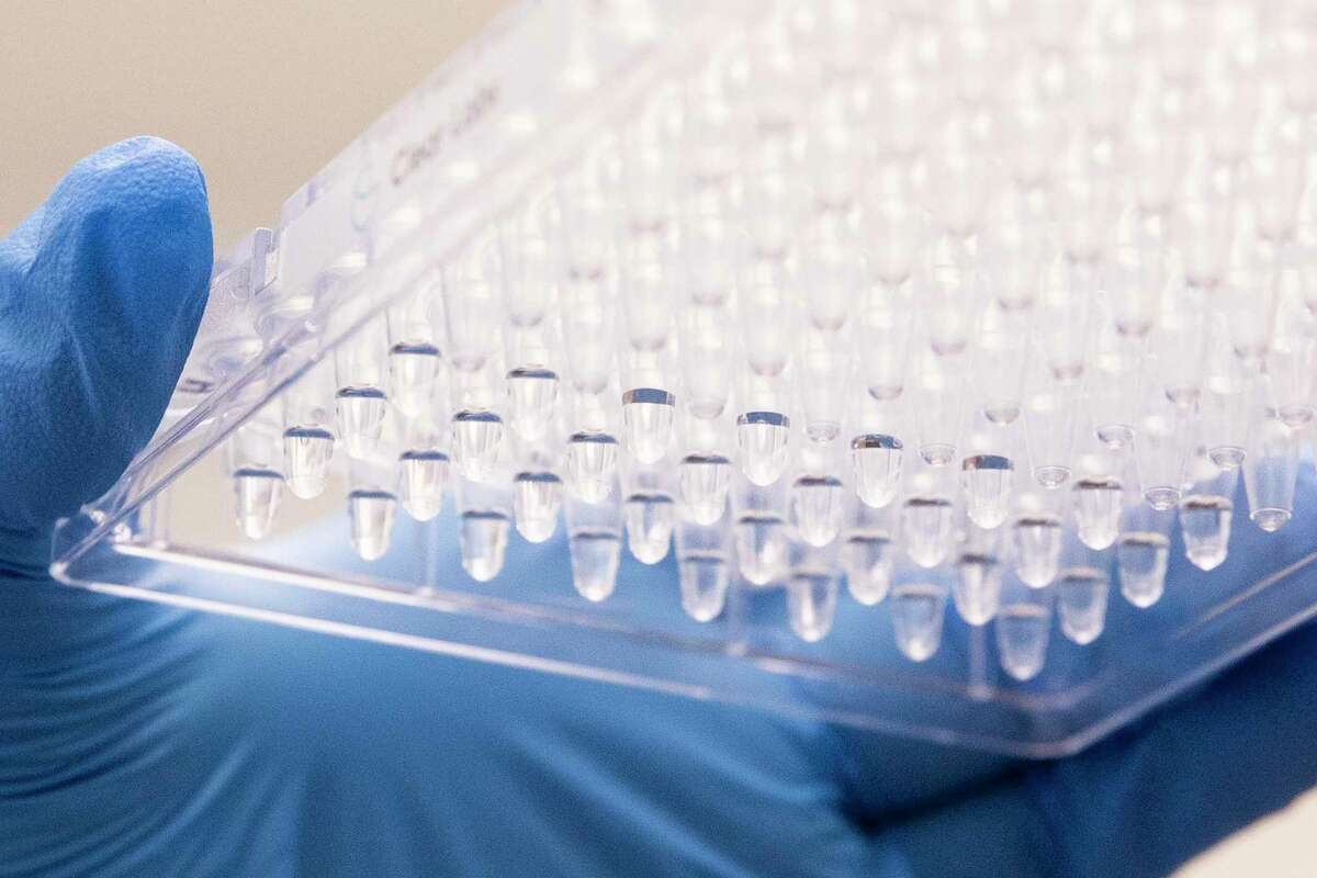 Lab technician Aamina Zahid prepares diluted samples of COVID-19 before running them through the state-of-the-art Clear Lab genomic sequencer while inside the Contra Costa County Public Health Lab at the Contra Costa Regional Medical Center in Martinez, Calif. Thursday, May 27, 2021.