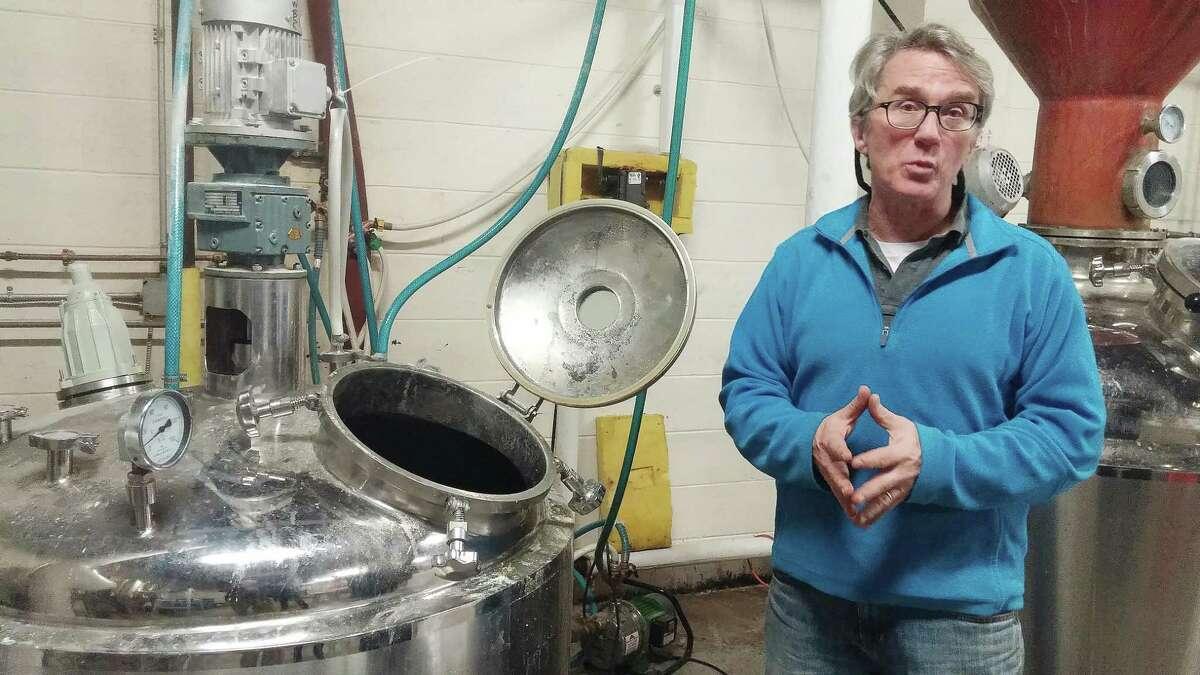 Rob Schulten explaining the distilling process at Asylum Distillery in Bridgeport.