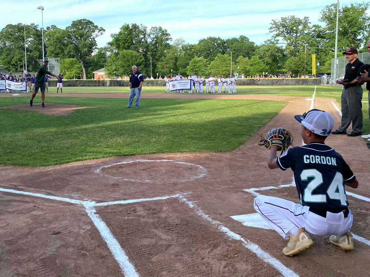 Norwalk coach throws out the first pitch at the opening ceremony of the District 1 Little League Tournament.