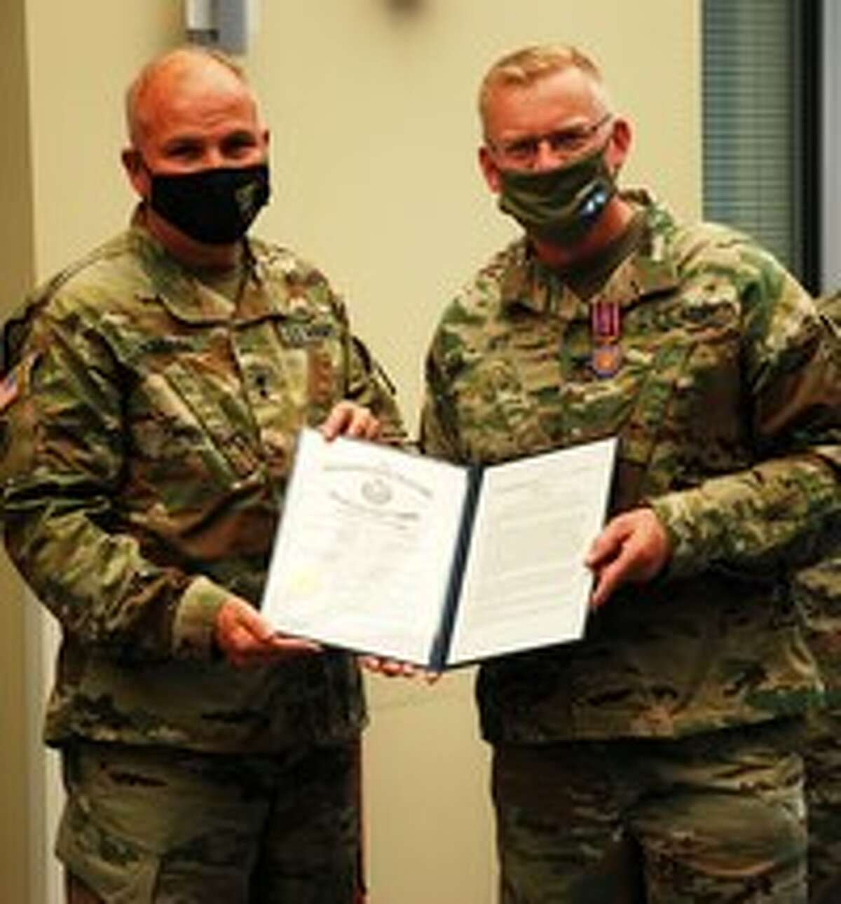 Col. Bob Epp, right, receives a New York State Conspicuous Service Medal from Maj. Gen. Ray Shields, the state adjutant general, in Latham.