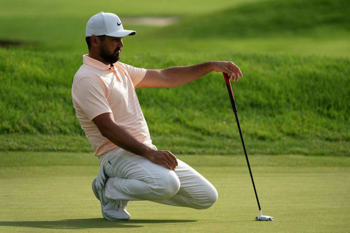 Jason Day lines up his shot on the ninth green during the second round of the Travelers Championship golf tournament at TPC River Highlands, Friday, June 25, 2021, in Cromwell, Conn. (AP Photo/John Minchillo)