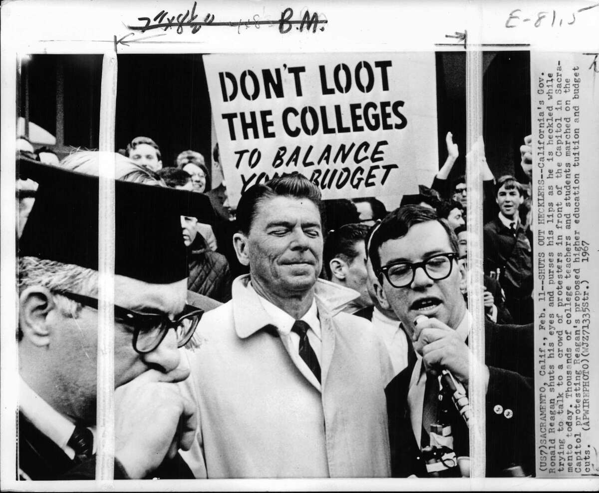 Then-California Governor Ronald Reagan is heckled over school budget cuts while trying to talk to a crowd of protesters in front of the Capitol in Sacramento.