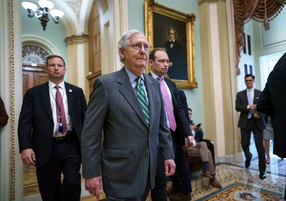 Senate Minority Leader Mitch McConnell, R-Ky., returns to the chamber after a news conference to criticize the Democrat push to pass a voting rights bill, at the Capitol in Washington, Thursday, June 17, 2021.