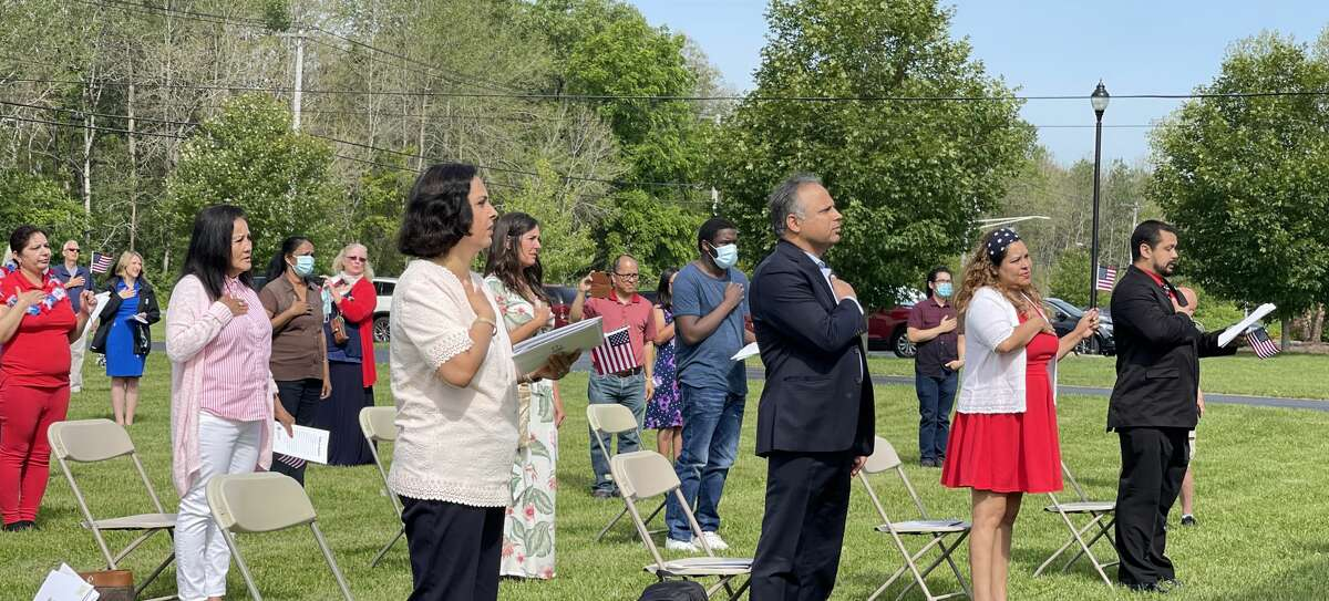 The Schenectady County Clerk, in partnership with the New York State Office of Court Administration and U.S. Citizenship and Immigration Services held a Naturalization Ceremony at the historic Mabee Farm in Rotterdam Junction June 25. Thirty applicants from 17 countries took part. Judge Christine Clark presided. County Clerk Cara M. Ackerley administered the Oath of Allegiance.