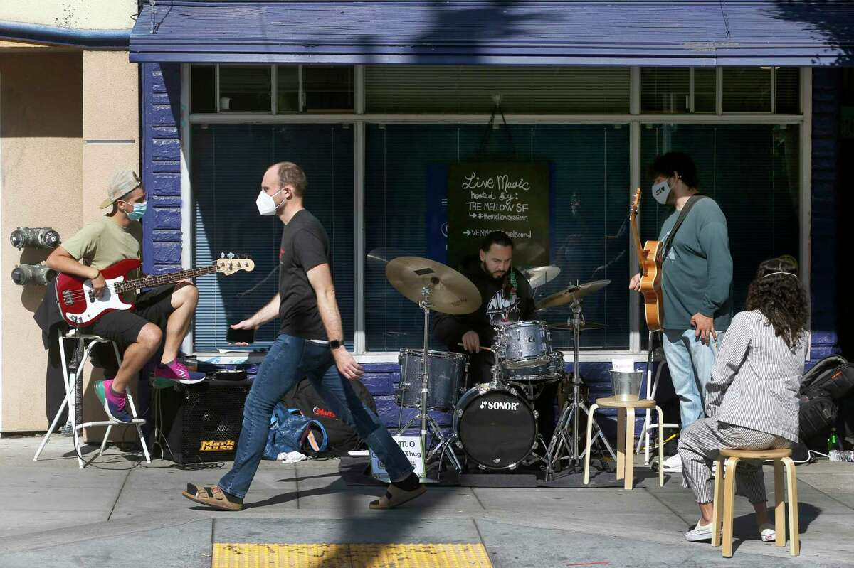 A pop-up band on 21st Street near the 900 block of Valencia Street, which is closed to vehicle traffic on weekends for San Francisco's Slow Streets program. The Chronicle's Charles Lews III says that he'll still wear a mask, even though he's fully vaccinated.