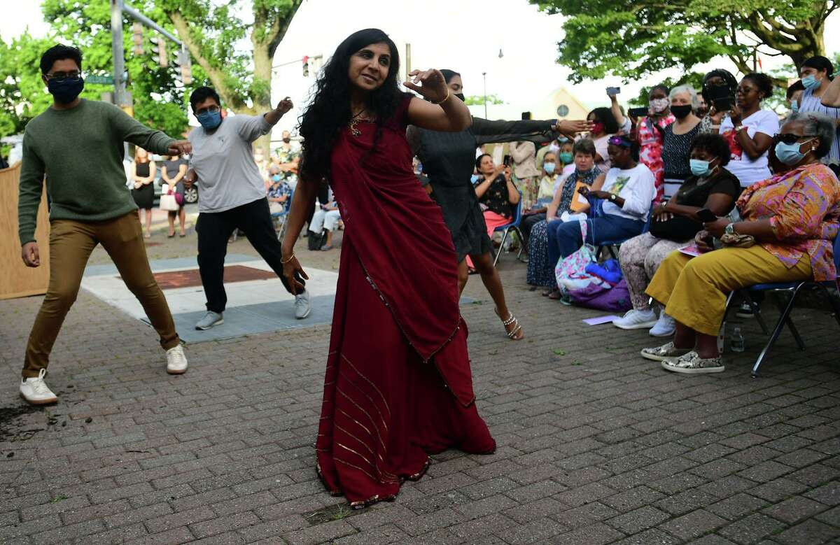 Yashasvi Jhangiani leads a traditonal Indian dance as nearly 100 people gathered for the dedication ceremony for the rose garden renamed after Divya Misra, a Norwalk Public Library employee, Friday June 25, 2021, at the library in Norwalk, Conn. Divya Misra was killed by her husband in May, according to authorities.