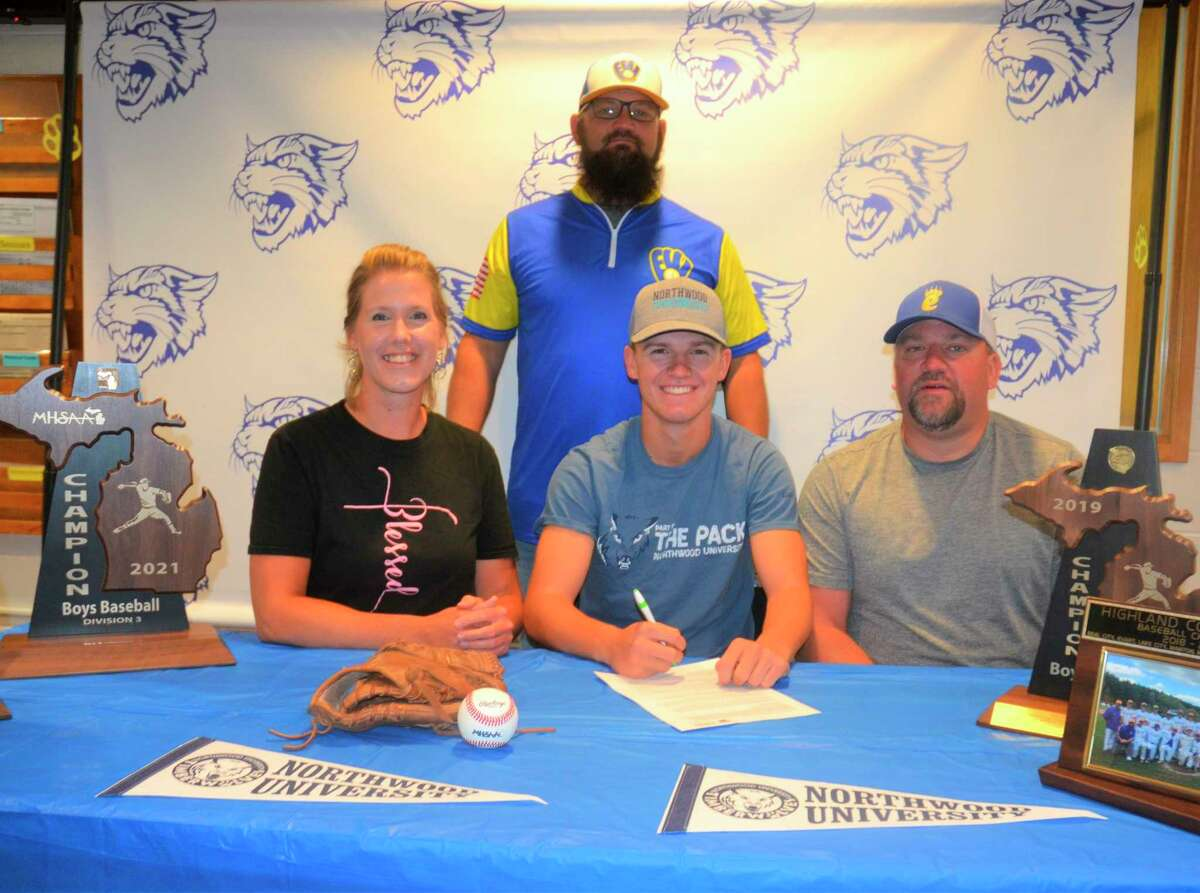 Evart's Danny Witbeck signed a national letter of intent earlier thisweek to play baseball at Northwood. His parents Katie and Torey, and Coach Josh Johnson (back) are also pictured. (Courtesy photo)