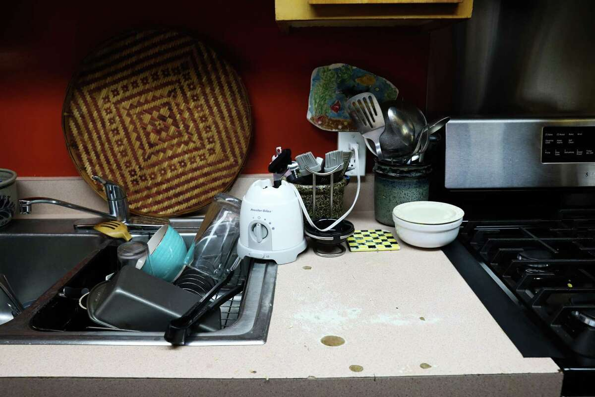 Royce McLemore's kitchen countertop is one of many surfaces that need to be replaced inside her apartment at Golden Gate Village.