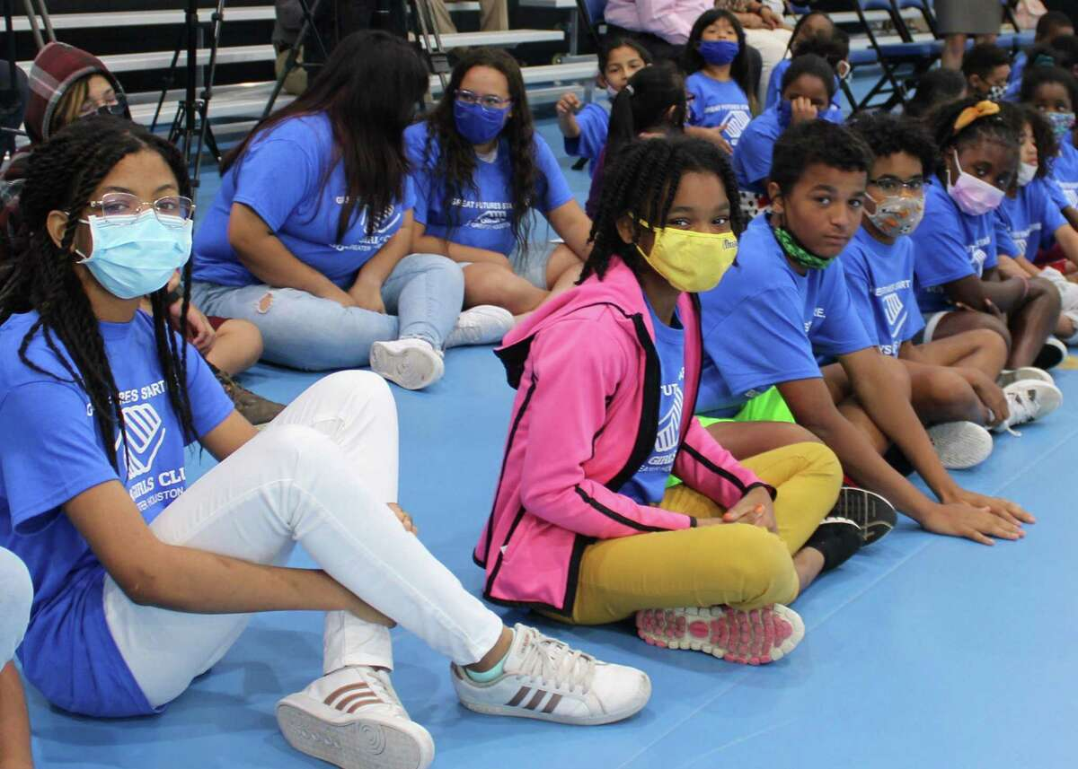 Club members of Boys & Girls Clubs of Greater Houston await a ribbon-cutting on Thursday, June 24, at their new Mission Bend Club, located at 8709 Addicks Clodine Road in Houston.