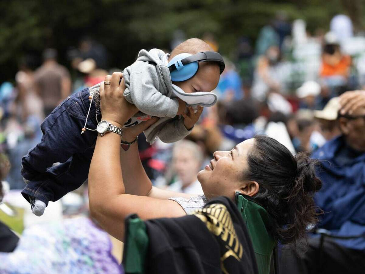 Mary Tiamzon-Lee holds Braxton Lee, 8-month, before the start of the Stern Grove Festival on Sunday, June 20, 2021 in San Francisco, Calif.