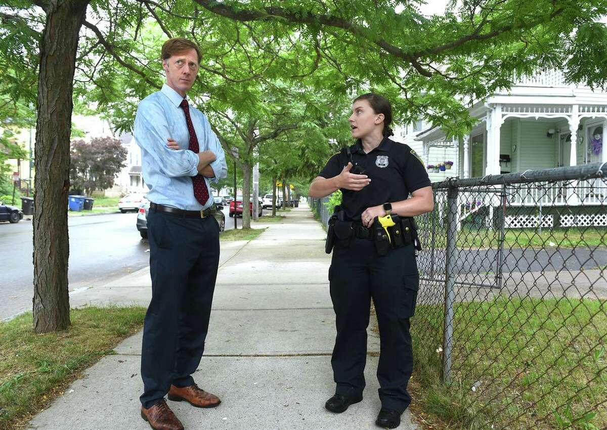 New Haven Mayor Justin Elicker speaks with Officer Margaret Luciani as she walked her beat with Officer Endri Dragoi (not in photo) on June 22, 2021 near the Whalley Avenue substation.
