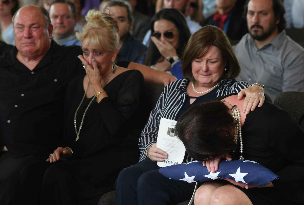Jennifer Pate is consoled by her mother Martha Brown Pate after being presented with the flag covering her father's casket during military honors at the funeral service for W.L. Pate at One City Church Friday. Photo made Friday, June 25, 2021 Kim Brent/The Enterprise