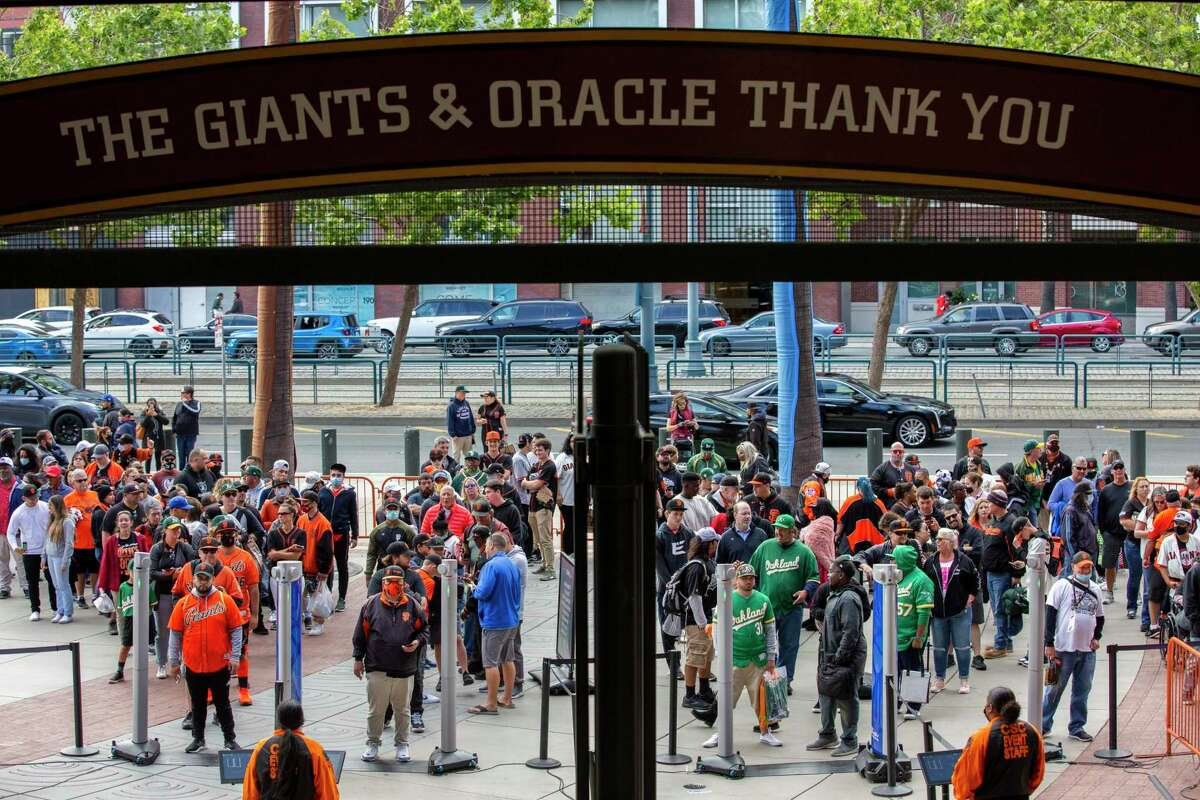 Fans wait to enter Oracle Park for Friday's game, the first without a capacity limit since 2019.