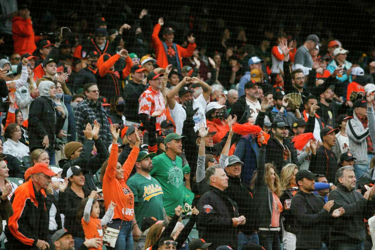 The fans during an MLB game between the San Francisco Giants and Oakland Athletics at Oracle Park, Friday, June 25, 2021, in San Francisco, Calif. It's the first game at the park without a capacity limit since the start of the coronavirus pandemic limited or banned spectators at sports venues.