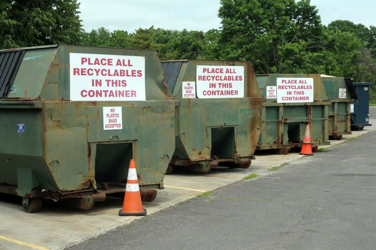 Dumpsters where residents can dump their recycling items at the town's transfer station, in Fairfield, Conn. June 25, 2021.
