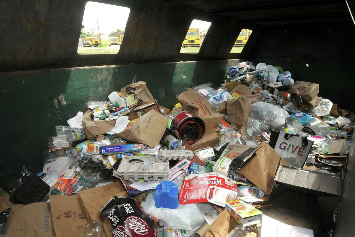 A look inside one of the dumpsters where residents can dump their recycling items at the town's transfer station, in Fairfield, Conn. June 25, 2021.