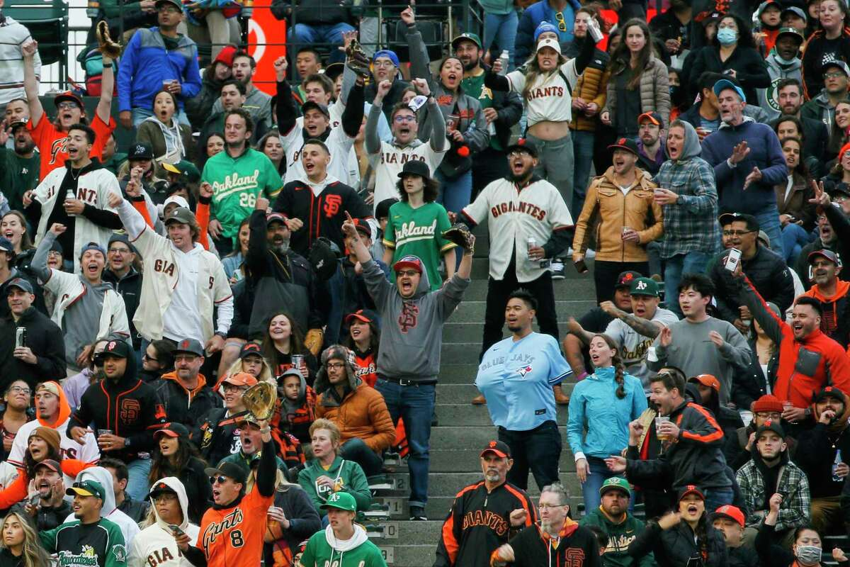 Fans cheer as the Giants score on Brandon Crawford's single in the fourth inning at Oracle Park.