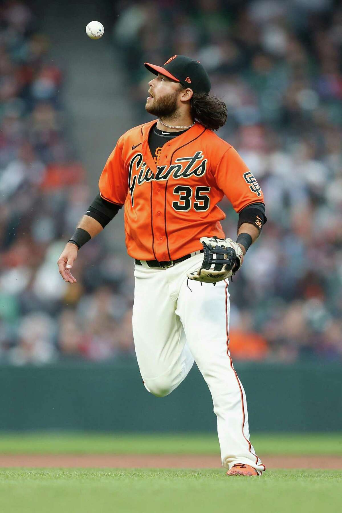 SAN FRANCISCO, CALIFORNIA - JUNE 25: Brandon Crawford #35 of the San Francisco Giants is unable to field the ball hit by Matt Chapman #26 of the Oakland Athletics in the top of the third inning at Oracle Park on June 25, 2021 in San Francisco, California. (Photo by Lachlan Cunningham/Getty Images)