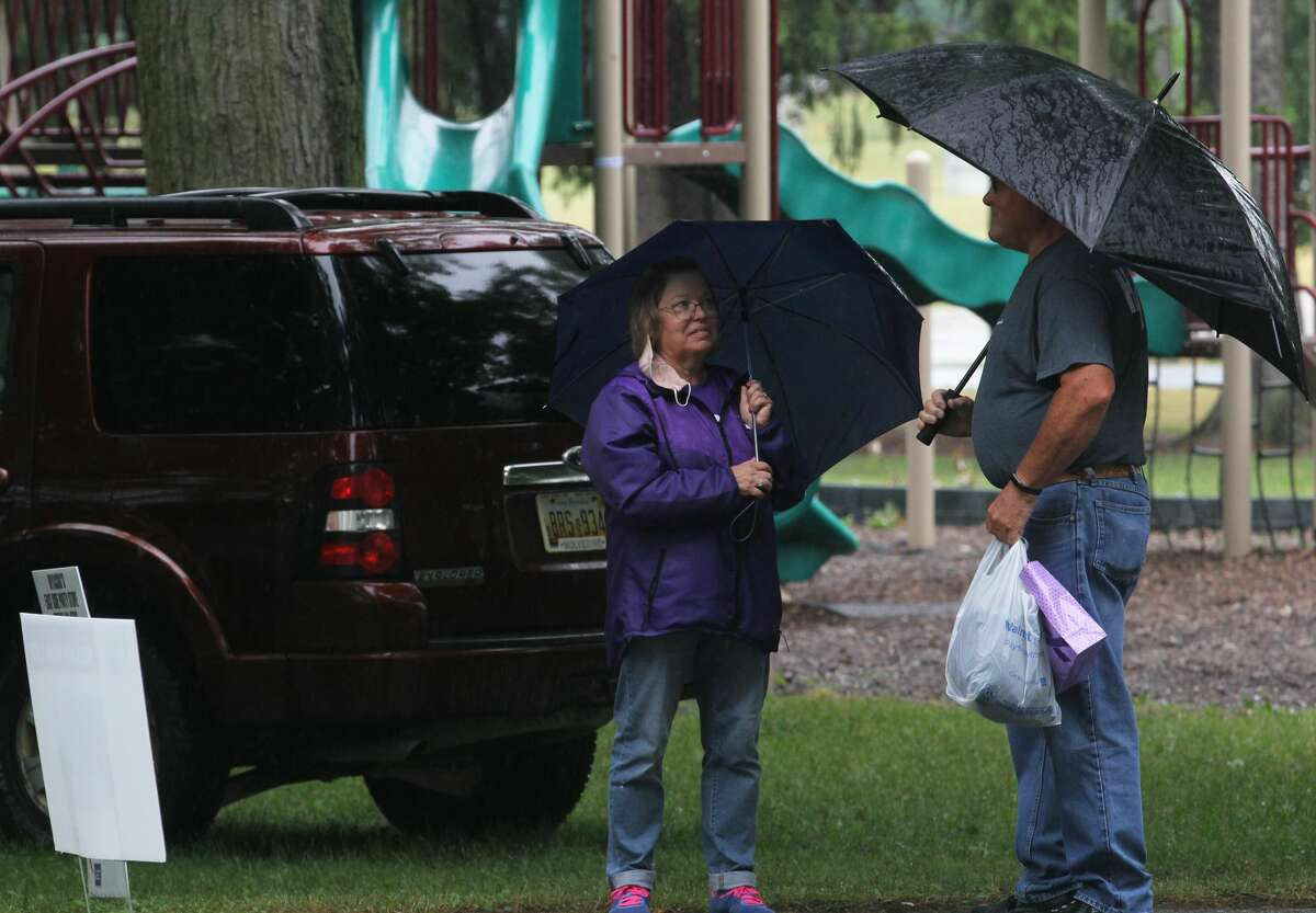 Survivors, their caretakers and supporters didn't let steady rain keep them from celebrating their victories over cancer, remembering those loved ones lost and raising money for the American Cancer Society during the annual Relay For Life of Huron County on Friday at Bad Axe City Park.