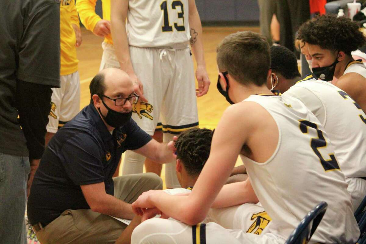 Baldwin coach JJ Eads (left) continues with his summer program. (Star file photo)