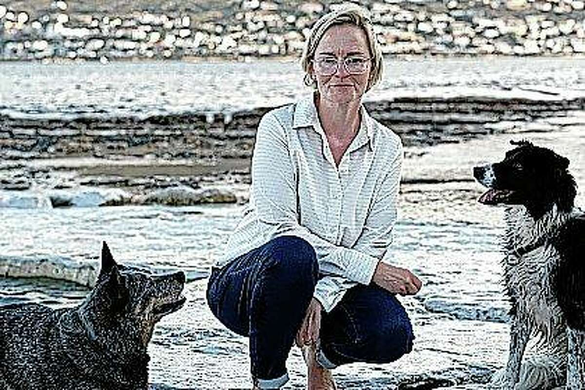 Pet custody specialist Karis Nafte with her dogs Sam (left) and Jax. Nafte helps couples settle disputes over their pets as more states move to make it easier for judges to consider the best interests of companion animals in divorce.