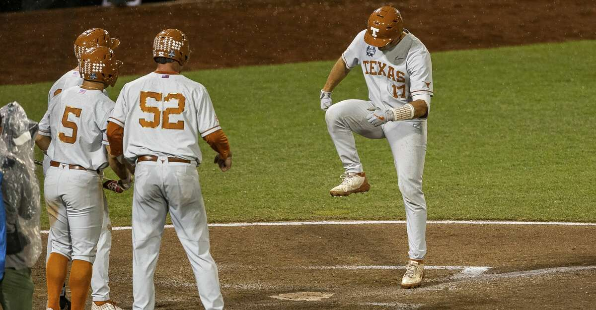 Texas' Ivan Melendez (17) stomps on home plate after hitting a home run also scoring Zach Zubia (52) and Mike Antico (5) against Mississippi State in the ninth inning during a baseball game in the College World Series Friday June 25, 2021, at TD Ameritrade Park in Omaha, Neb. (AP Photo/John Peterson)