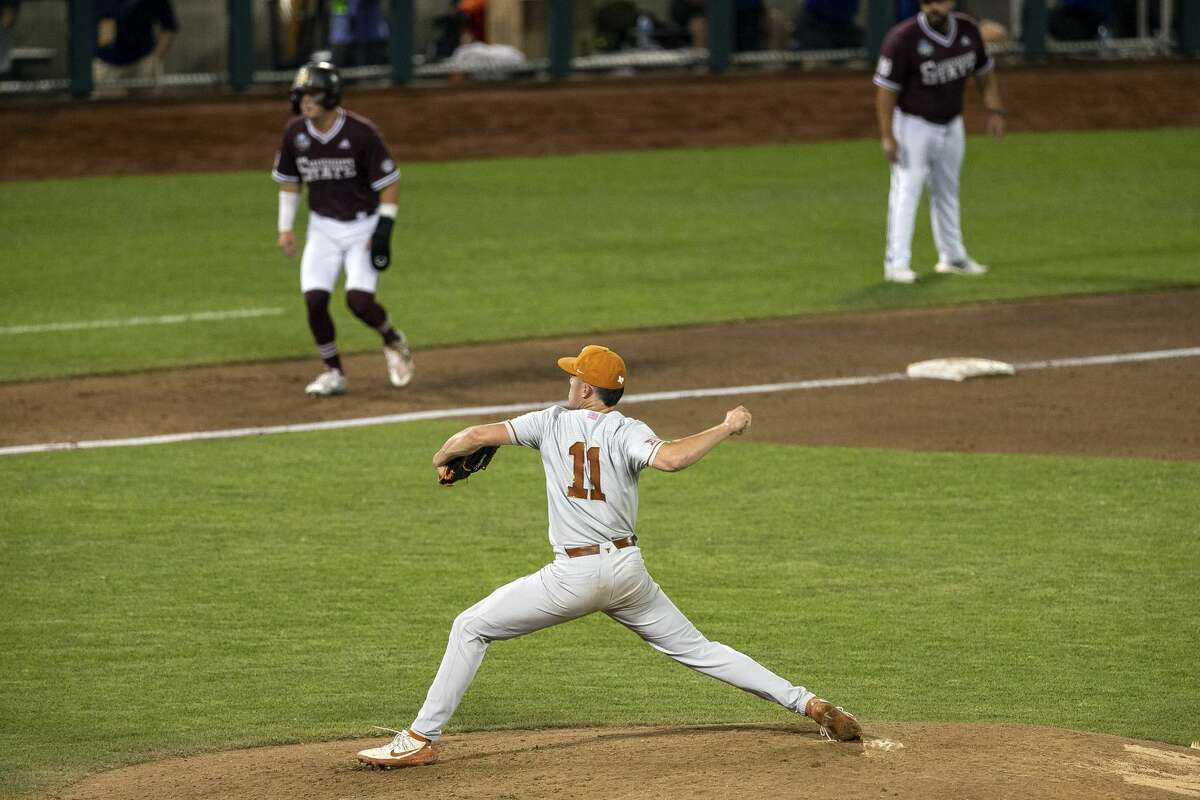 Texas's Tanner Witt (11) throws a pitch to Mississippi State's Scott Dubrule (3) in the eighth with Tanner Allen (5) leading off of third base during a baseball game in the College World Series Friday June 25, 2021, at TD Ameritrade Park in Omaha, Neb. (AP Photo/John Peterson)